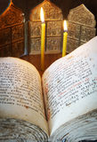 Orthodox Christian still life with open book and burning candles Stock Images