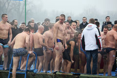 Orthodox Christians celebrate Epiphany with traditional ice swimming Stock Photos