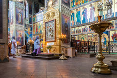 Orthodox Christians inside the Assumption Cathedral Stock Photo