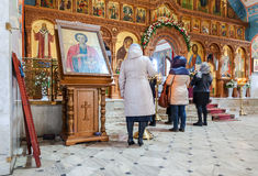 Orthodox Christians inside the Church of  Resurrection in the Ho Stock Photo