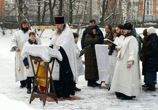 Orthodox Christians participate in a Christening Royalty Free Stock Photography