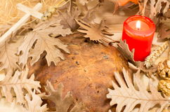 Orthodox Christmas bread covered with Yule log leaves. Orthodox Christmas bread covered with Yule log dry leaves Stock Photos