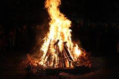 Orthodox Christmas Eve celebration. Orthodox ritual. Fire, burning wood. Serbian, Russian Christmas ceremony. Fire, burning wood. Orthodox Christmas ritual stock image