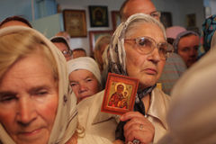 In the Orthodox church. Russia. Tomsk. Older women with icons are in the Orthodox church in anticipation of service Royalty Free Stock Photo