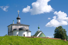 Orthodox Church. Against the background of clouds and grass Stock Photography