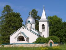 The orthodox church. Stands on the hill with green grass Royalty Free Stock Image