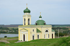 Orthodox church above the river Stock Photos