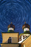 Orthodox Church against the starry tracks. Stock Photography
