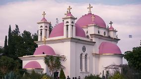 Orthodox Church of the 12 apostles. Sea of Galilee. CAPERNAUM,ISRAEL - FEBRUARY 20:Orthodox Church of the 12 apostles.Temple with red domes on buckwheat field on stock video
