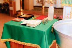 The Orthodox Church attributes, font ,icon ,cross , prayer room inside the Church Stock Photos