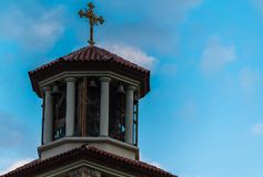 Orthodox Church Bell Cross. Imposing cross on top of a bell tower, decorated with a perfect blue sky royalty free stock image