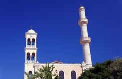 Orthodox church with a bell tower and minaret Royalty Free Stock Photography
