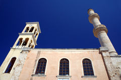 Orthodox church with a bell tower and minaret Stock Image