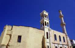 Orthodox church with a bell tower and minaret Royalty Free Stock Photos