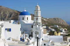 Orthodox church and bell tower in Pyrgos, Santorini, Greece. Royalty Free Stock Photos