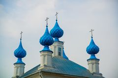 The Orthodox Church with blue domes in Russia. Stock Photos