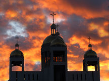 Orthodox church crosses under dramatic sunset Royalty Free Stock Photography