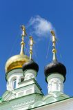 Orthodox church domes with gilded crosses in clear blue sky Stock Images