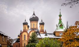 Orthodox church with domes and snow stock image
