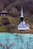 Orthodox church and drowned cemetery. Waste lake with cyanide po. Orthodox church and flooded cemetery next to drowned village at Geamana lake near gold mine of Royalty Free Stock Images