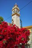 Orthodox church with flowers in Karavomilos village, Kefalonia, Greece Stock Photo