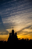 Orthodox Church of George Pobedonosets in the village of Romanovo Kaluga region (Russia) at sunset. Stock Image