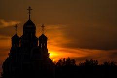 Orthodox Church of George Pobedonosets in the village of Romanovo Kaluga region (Russia) at sunset. Royalty Free Stock Image