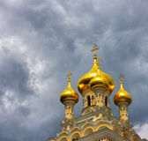 Orthodox church with golden domes. Royalty Free Stock Image
