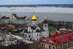 Orthodox church with golden domes. Black roof and bell tower Royalty Free Stock Photo