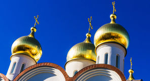 Orthodox church with golden spiers. And blue sky Stock Photography