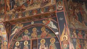 Orthodox church - interior paintings. Interior of orthodox church - interior paintings and saints stock video