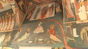 Orthodox church - interior paintings. Interior of orthodox church - interior paintings and saints on the wall and dome stock footage