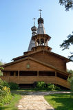The Orthodox Church of logs with wooden domes Stock Image