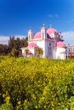 Orthodox Church and Mustard Field near Galilee Sea Stock Photos