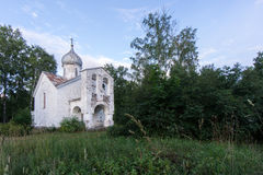 Orthodox Church and nature. Green garden and architecture. Under the blue sky a house which is surrounded by a beautiful nature Royalty Free Stock Photography