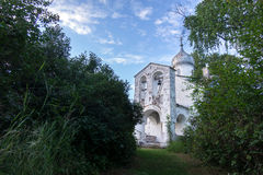 Orthodox Church and nature. Green garden and architecture. Under the blue sky a house which is surrounded by a beautiful nature Stock Images