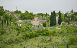 The Orthodox Church. The old Orthodox Church enclosed by a stone wall with a cemetery inside on the shores of the Skadar Lake at Montenegro Stock Images