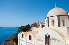Orthodox church overlooking the caldera and the volcano. Fira, Santorini in Greece. Royalty Free Stock Photos