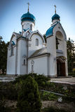 Orthodox church in the park. Church in the park in Daugavpils, Latvia, clear blue sunny sky in the background Royalty Free Stock Image