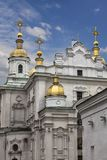 Orthodox Church. Poltava. Ukraine. Old Orthodox Dormition Cathedral Kiev Patriarchate. Gold domes close-up against a blue cloudy sky. Monument of architecture of Royalty Free Stock Image