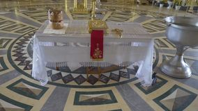 Orthodox Church. preparation for the baptism of the child. with the bible, water, cross on the table stock footage