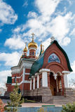a Orthodox church from a red brick against the blue sky Stock Image