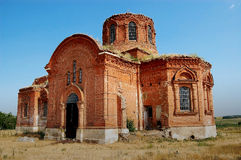 The Orthodox Church in the remote village on a hill. Royalty Free Stock Photo