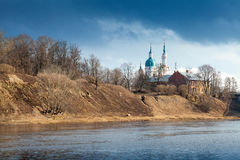 Orthodox church on river coast. Kingisepp Royalty Free Stock Photo