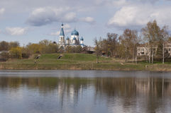 The Orthodox Church in Russia. Lake and blue sky. The Orthodox Church in Gatchina, Leningrad region. Saint Petersburg, Russia Royalty Free Stock Photography