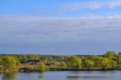 The Orthodox Church in the Russian village, standing on the river bank. The Russian Plain.  Stock Photo