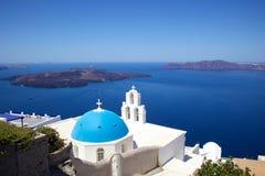 Orthodox Church in Santorini, Greece. Iconic blue dome church against blue sky beside Aegean sea on a Greek island, Santorini, Greece Stock Photography