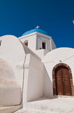 Orthodox church in Santorini with tower , Grece Royalty Free Stock Photography
