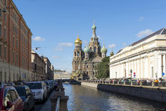 Orthodox Church of the Savior on spilled blood in St. Petersburg. Griboyedov Canal, street, people, cars, dome, Russia Stock Photography