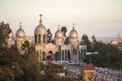 Orthodox church service, Ethiopia. ADDIS ABABA, ETHIOPIA-OCTOBER 31, 2014: Unidentified worshippers conduct a church service at a large Ethiopian Orthodox church stock photography